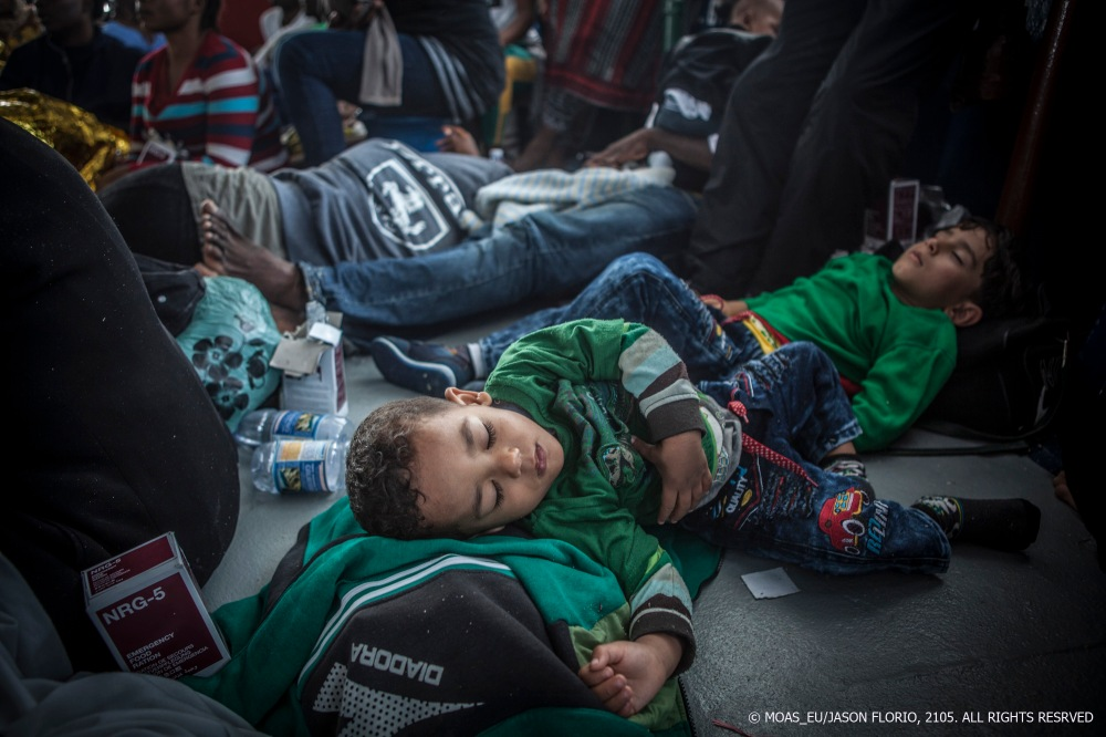 Palestinian-Syrian boys Mohammed and Amar sleep on the decks of the MOAS rescue ship The Phoenix after being rescued